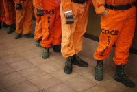 Prison inmates wearing firefighting boots line up for breakfast at Oak Glen Conservation Fire Camp #35 in Yucaipa